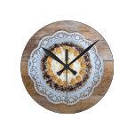 Almond nut cake on rustic wood round wallclock