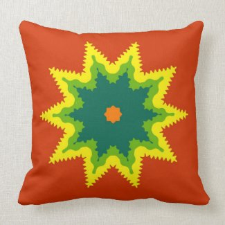 Artistic mandala on orange throw pillow