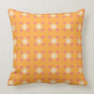 Floral pattern on orange throw pillow