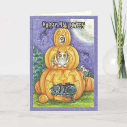 halloween card with cats in pumpkins