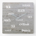 Modern beach driftwood ocean sea typography square wall clock