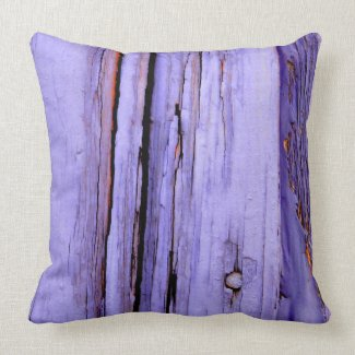 Old cracked purple paint on wood throw pillow