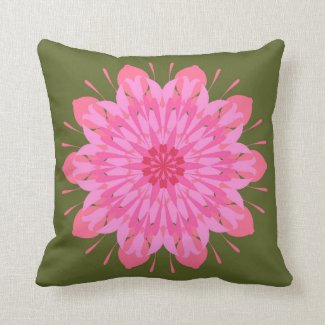 Pink mandala on green throw pillow