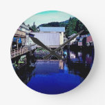 Royal Blue Stream Through Town Reflection Round Wall Clock