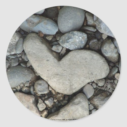 stone heart on a gravel road sticker