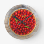 Strawberry cake with mint leaves on a rustic wood round wall clock