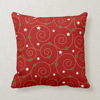 Swirls and stars on red pillow