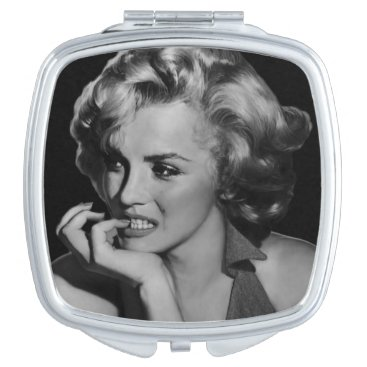 The Thinker Compact Mirror