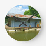 Vintage Abandoned Boat Dock House on Water Round Clock