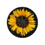 yellow sunflower on brick wall round clock