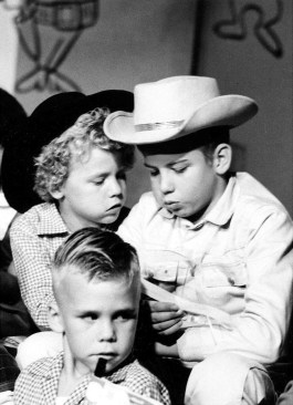 "Cowkid siblings, Phyllis and Elmo Brown, read a note while on the set of the ""Uncle Jay Show "" in the black and white days of television. As it turns out, their father was operations manager of that Austin, Texas, TV station and it was obvious from early on how close a family an organization like this could be. Well, many of the station 's employees actually were related since Lyndon Johnson owned the company and several of his relatives were employed there. And come to think of it, a few stepmothers to these two little cowpokes came out of that workforce, as well. So maybe it didn't feel so much as family as in some ways it actually was family!"