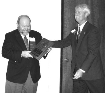 John Robinson presents Randy Ray with an Honorary Membership Award.