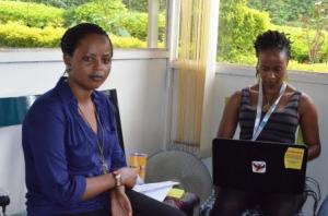 SUGI Patricia, Ni Nyampinga journalists trainer at Girl Hub Rwanda (On her laptop)