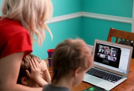 Kids online distance learning with mom during COVID