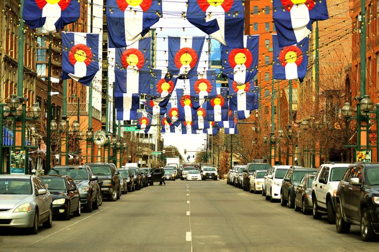 Larimer square in downtown Denver with many Colorado flags strewn overhead