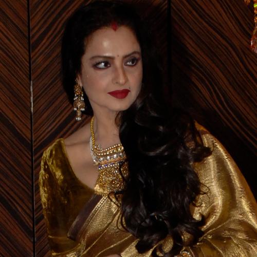 Rekha in her signature side swept hair