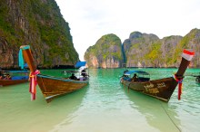Fishing boats at rest in the bay of Kho Phi Phi, Thailand.