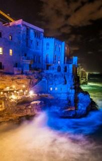 The illuminated waves crashing against the coast when I arrived