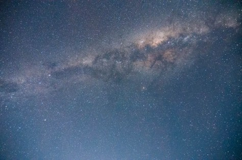 The Milky Way hangs brightly in a pitch black night in the Australian Outback,