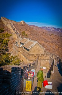 A local man sells beer, soft drinks and snacks on the Great Wall of China. Beijing, China.