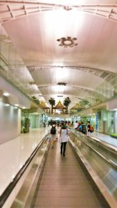 It's a long walk from the gate at Bangkok airport to immigration/baggage claim. Make sure you pay attention, otherwise it can be confusing.