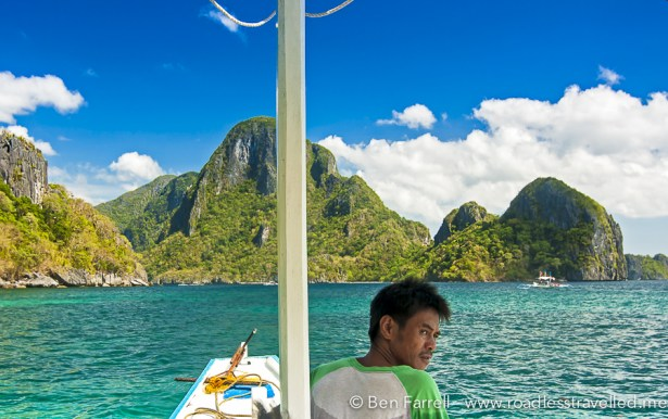 Navigating out of the calm blue waters of the El Nido Bay.
