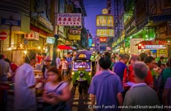 A tuk tuk cuts through the masses in Bangkok, Thailand