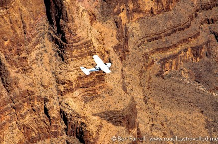 A light plane flies below us through the canyon.