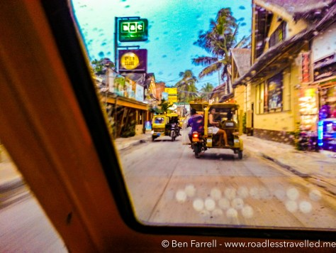 Cruising the main street of Boracay behind the beach