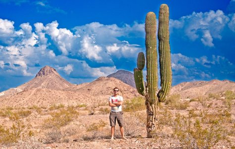 Posing with a cactus during my road trip in the Sonoran Desert