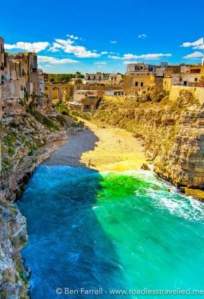 The blue Adriatic Sea graces a hidden cove in Polignano a Mare, Italy