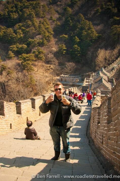Enjoying a Tsing Tao beer on the Great Wall of China