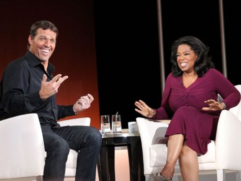 Motivational speaker Tony Robbins with Oprah Winfery