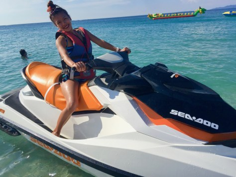 Jen riding the jet ski at White Beach