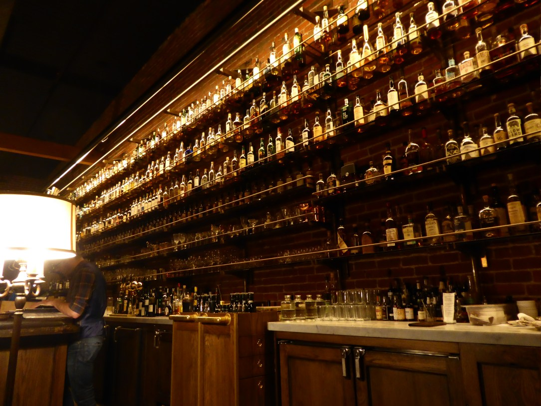 Wall of whiskey in the Multnomah Whiskey Library