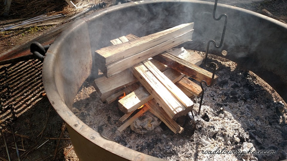 stacked logs in campfire