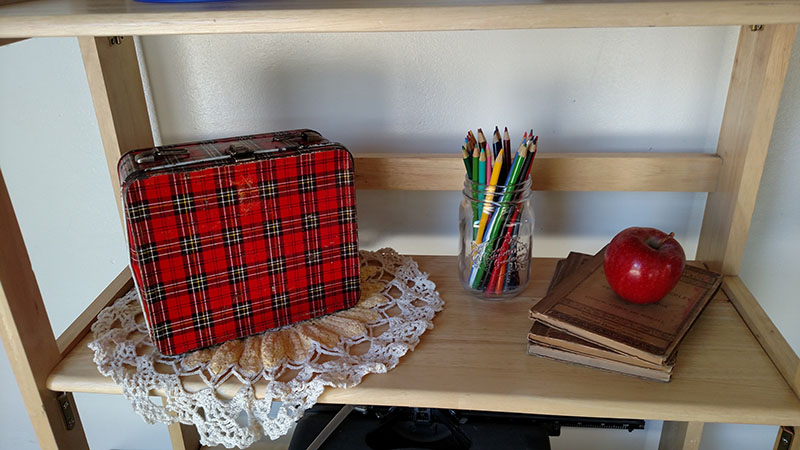 nostalgic plaid lunch box with vintage books