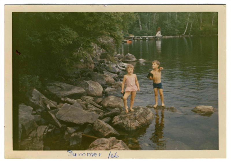 two kids at a lake