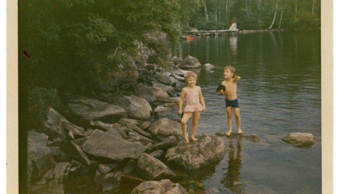 two kids at a lake