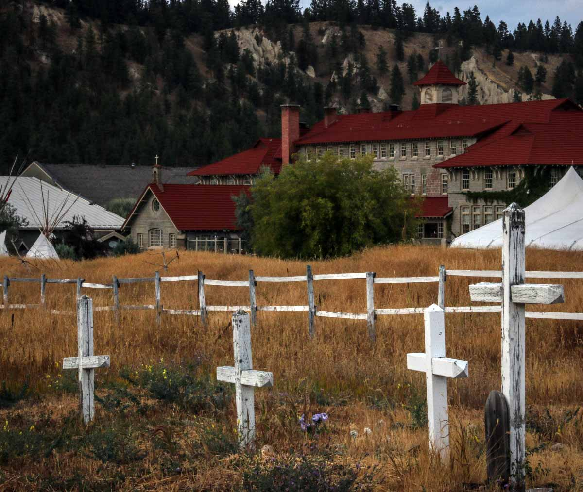 crosses in front of the St. Eugene Mission Red Brick Schoolhouse