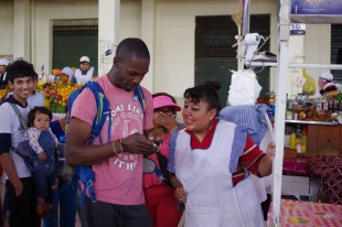Kori exchanging numbers with a meat vendor
