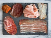 Variety of meats on a stone board