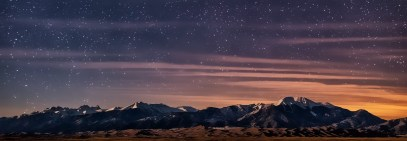 night sky with stars over mountains