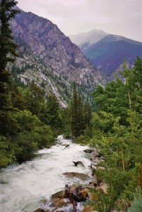 flowing stream with mountains in background