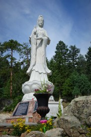 tall white marble statue of Buddhist woman