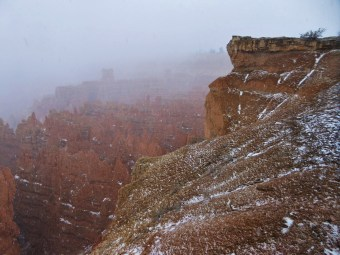 Hoodoos in the fog and snow at Bryce Canyonb
