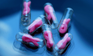 Capsules containing pink ribbons