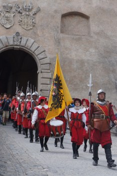 Marchers in a parade during the Five-Petalled Rose Celebrations