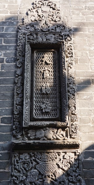 Intricate carving on the side of building