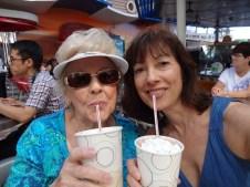 Mom and me drinking milkshakes.